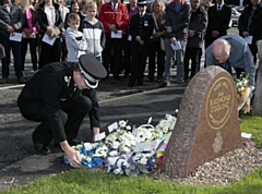 A wreath is laid in memory of Inspector Ray Codling, who was killed on duty at Birch Services