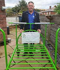 John Keogh with the Springhill Hospice bed