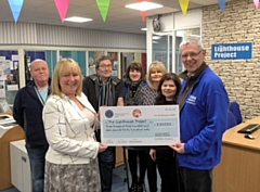 Marie Gribben from Middleton Shopping Centre presents a cheque to Carl Roach from the Lighthouse Project