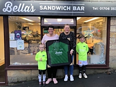 Bella's Sandwich Bar staff with Ballers Coaching FC players