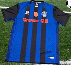 A shirt signed by Rochdale AFC is up for grabs