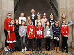 Mayor Billy Sheerin had afternoon tea with children who helped pack bags at local stores over Christmas