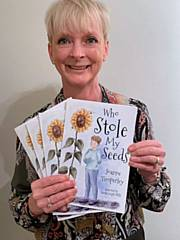 Joanne Timperley with her book, 'Who Stole My Seeds?'