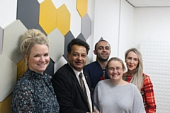 Councillor Ifikhar Ahmed, cabinet member for adult care (second left) congratulates Adi Dalman (second right) on her award success, with staff from PossAbilities