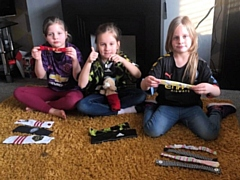 Milnrow triplets sew PPE headbands for NHS workers