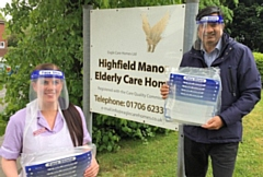 Kimberley Haigh, Deputy Manager of Highfield Manor Care Home receives a donation of face visors from Councillor Faisal Rana
