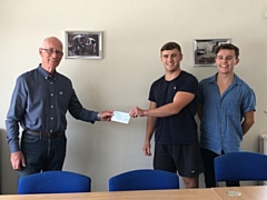 David Canavan (RSPCA trustee) receives the cheque from Brad and Liam Gartland
