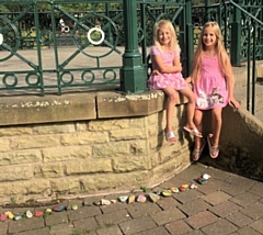 Maisie-Rae and Evie with the rock snake at the bandstand in Hare Hill Park