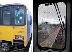Damage to train window caused by a stone thrown from a bridge
