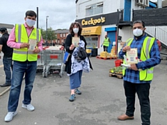 Councillors, health officers and volunteers handed out advice and face masks to residents on Saturday 25 July