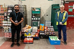 Mr Abdullah from Falinge Park High School delivers supplies to John Rowe at Rochdale Foodbank