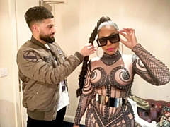 Mohammed Ilmaas styling singer Ashanti before one of her UK concerts