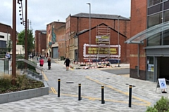21 Baillie Street is next to the entrance of the Wheatsheaf Shopping Centre, next to Rochdale Riverside