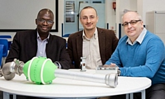 Bamidele Adebisi, Professor in Intelligent Infrastructure Systems, with, right, Paul Carrington, the CEO of Aquacheck Engineering and, centre, KTP associate Dario Chiantello with a prototype smart water meter developed via a Knowledge Transfer Partnership