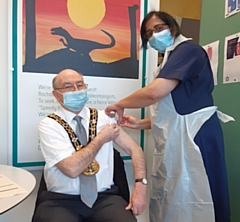 Mayor of Rochdale, Billy Sheerin gets his vaccination at Number One Riverside