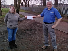 Rotary Heywood 2020 club secretary Edwin Partridge presents a cheque to Denise Dawson, receiving on behalf of 14th Heywood (Woodland) Guides, 7th Heywood (St. George's) Rainbows and 4th Ravenscroft Scouts