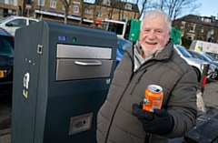 Council Leader Allen Brett trying out the new solar bin at Lake Bank