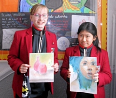 Harriet Whitbread and Ella Raw with their artwork