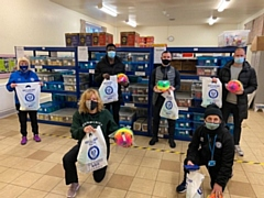 Community Trust Manager Siobhan McElhinney, Rochdale AFC players Kwadwo Baah, Jimmy Ryan and Matty Done (back row) along with kitman Jack Northover (front right) delivered care packs to the Community Warehouse at Sparth Community Centre