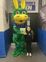 Dale Mascot Desmond the Dragon gives a book away