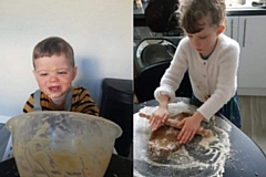 Rosie (right) and Theo (left) baking gingerbread men and cake, respectively
